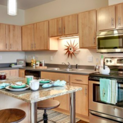 Kitchens have new appliances and honey-colored wood cabinets
