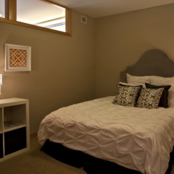 Bedrooms have high windows connecting them to the kitchen and living room