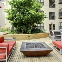 A courtyard has plenty of seating and a firepit