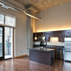 These lofts have spacious layouts and dark woodwork