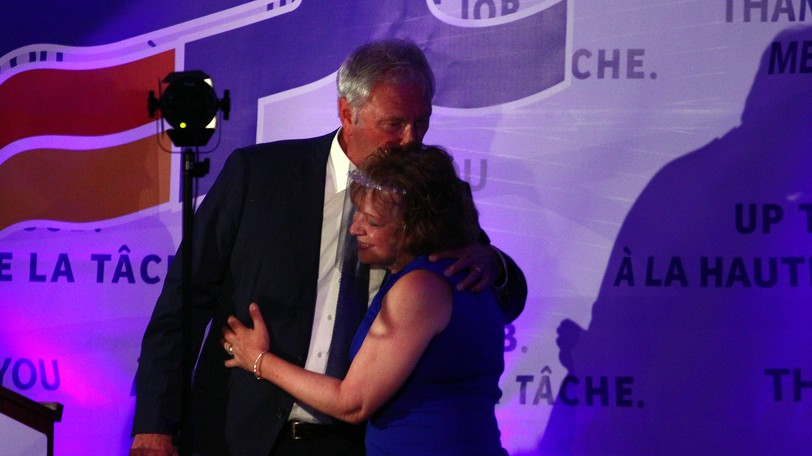 Premier Blaine Higgs and his wife Marcia embrace at the Island View Lions Club after securing a majority government on Sept. 14, 2020.
