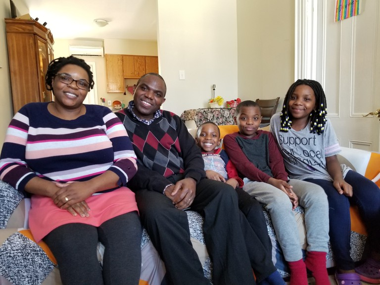 Assinath Mohindo and Etienne Basenge, with their children Regis, Roger and Divine, are pictured here in better days. Mohindo says she hasn't heard from her husband since Dec. 6 after he returned to Uganda to care for his ill mother.