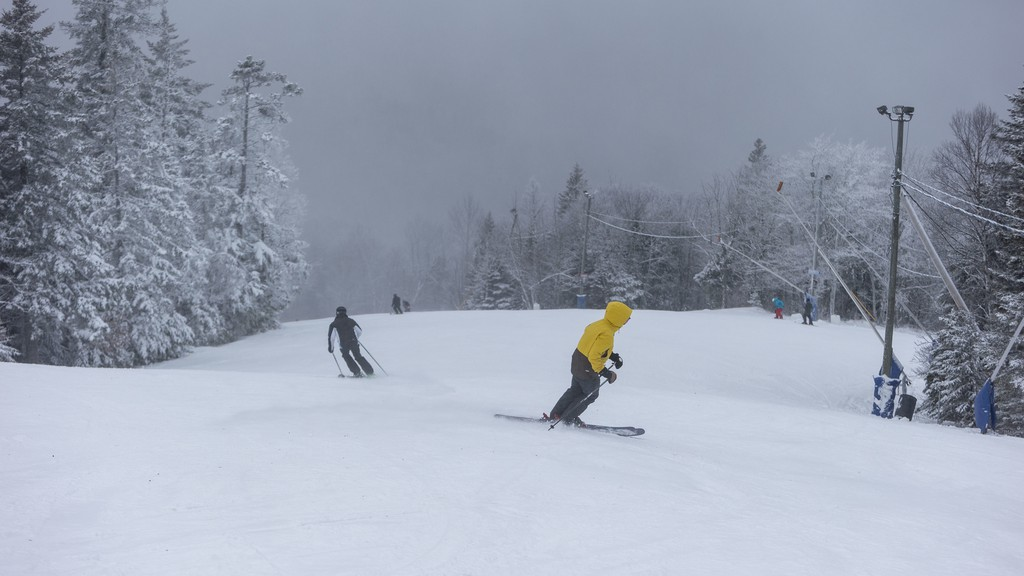 Skiers carve their way down the mountain Friday, Dec. 18 at Poley Mountain. The mountain has laid off more than 200 people as a result of it being forced to close its doors while the region is in the red phase of the province's pandemic recovery phase.