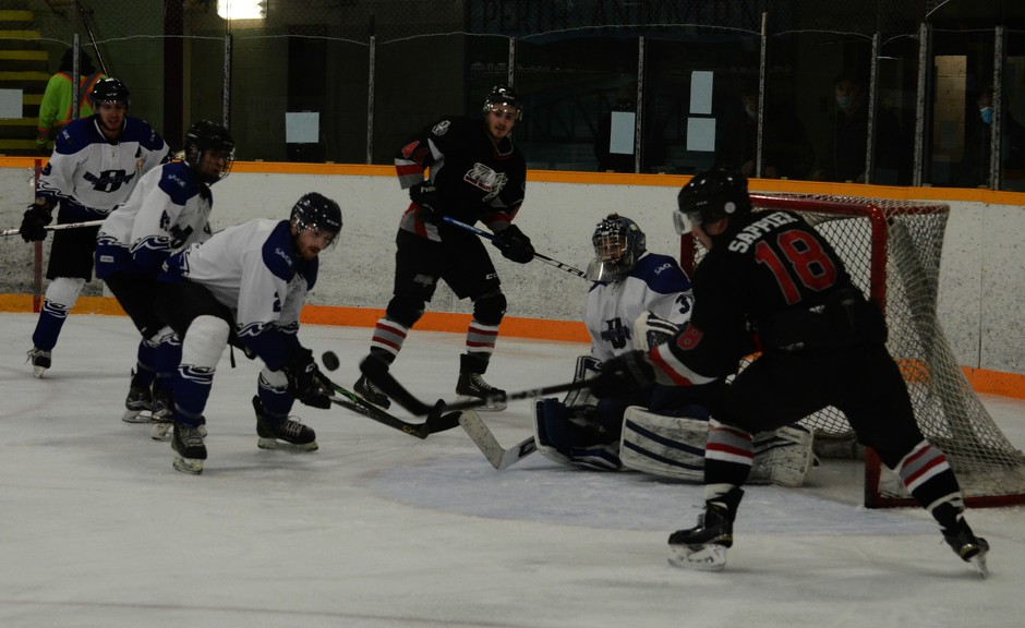 A decision is expected Sunday on whether teams in the Senior A men's Regional Hockey League, including the River Valley Thunder of Perth-Andover, will scrap their season or hold out for a return to play. In this file photo from an earlier game, Sheldon Sappier, Thunder player No. 18, tries to control the puck in midair. The Regional Hockey League remains on hold under current guidelines.