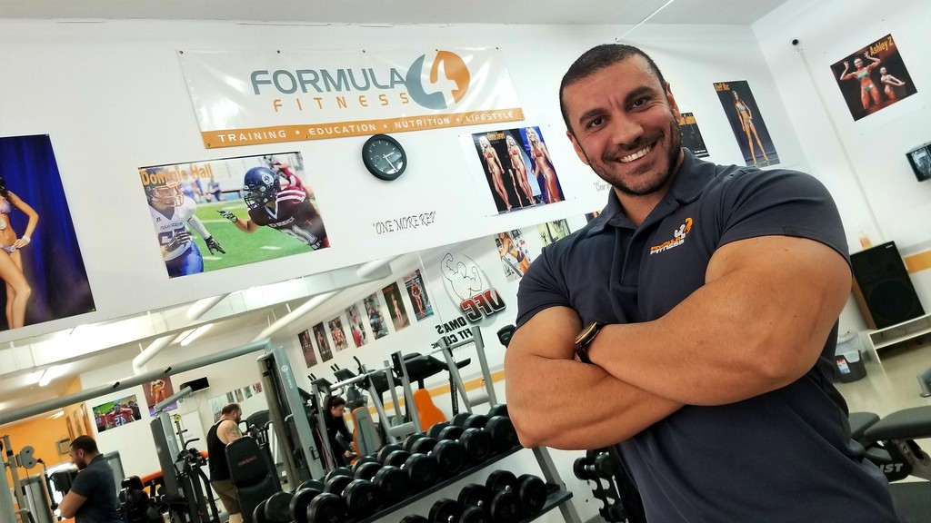 Omar Ali, founder and president of Formula 4 Fitness, stands in his fitness facility on the north side. The business is opening a second location, on Prospect Street on the south side, in April.