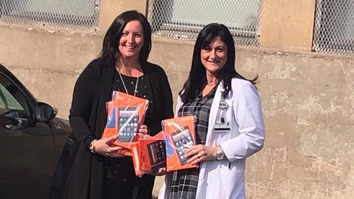 Tricia Friars, clinical director of Routinify, and registered nurse Kendra Sherwood are pictured here at St. Joseph's Hospital with a donation of Amazon Fire tablets back in March 2020. Friars says Routinify's in-home virtual case system is being used in key COVID-19 research, but her firm has gotten no commitment from the provincial government to adopt the system so it can be made widely available.