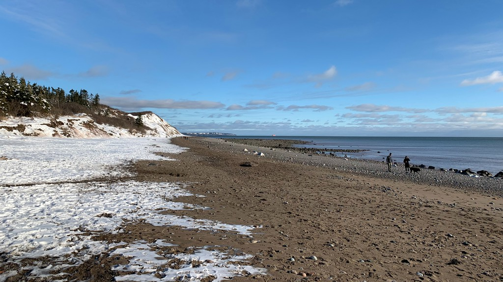 A mix of snow and sand on the beach at the Irving Nature Park.