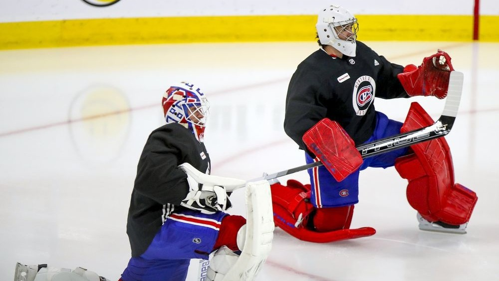 Fredericton's Jake Allen, left, and Carey Price stretch prior to a Montreal Canadiens training camp practice at the Bell Sports Complex in Brossard, Que. Allen and the Canadiens begin the NHL season in Toronto on Wednesday, the opener in a six-game road trip.