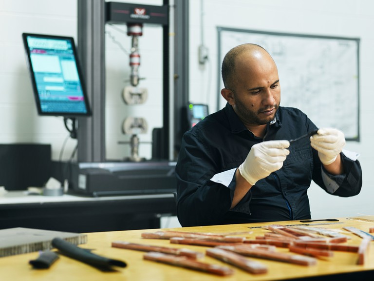 Dr. Ennouri Triki is shown analyzing samples in his laboratory of advanced materials located in Caraquet.