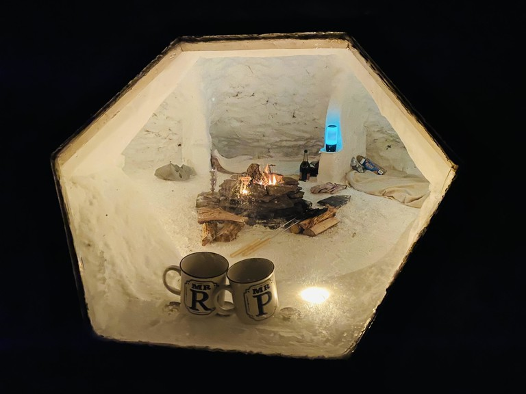 Welcome to  Philip Walker's 'swowzebo' - a snow temple he built this winter as a pandemic project, complete with a window and a firepit, as well as candles for atmosphere.