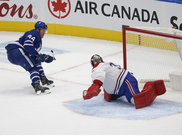Toronto Maple Leafs defenceman Morgan Rielly beats Montreal Canadiens goaltender Carey Price for the game-winning goal in overtime in Toronto on Wednesday.
