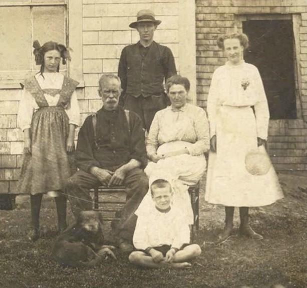 A look through the window of the past shows a photograph of Margaret Jean Morgan Cameron (1897-1970), John Edwin Morgan (1847-1919), Corey Carson, Mary Jane Irvine Carson Morgan (1860-1928), and Olive Anna Morgan Lawrence (1896-1945).
