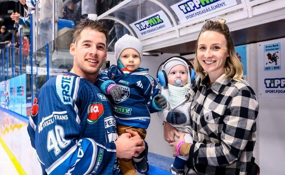 Former UNB Reds defenceman Jon Harty decided to hang up his skates at 32. He's shown here, in the 2018 season in the Austrian league, holding son Hendrix while wife Megan holds son Ellis.