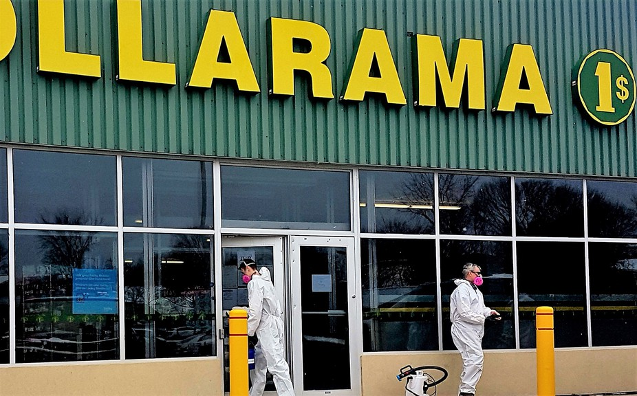 Employees with Advantage Cleaning prepare to deep-clean a Dollarama Store at 102 Main St., in Fredericton on Thursday. Nine of its stores in New Brunswick, including five Fredericton locations, were closed after an employee tested positive for COVID-19.