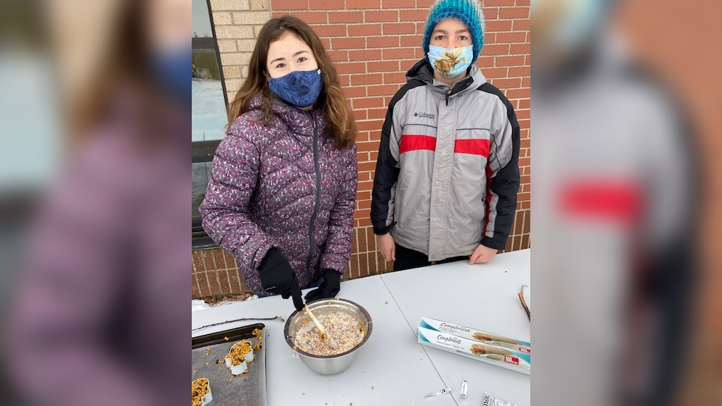 Grade 8 students Anna Titus and Eben Peterson make bird seed ornaments in teacher Julie Cyr's class at Rothesay Park School.