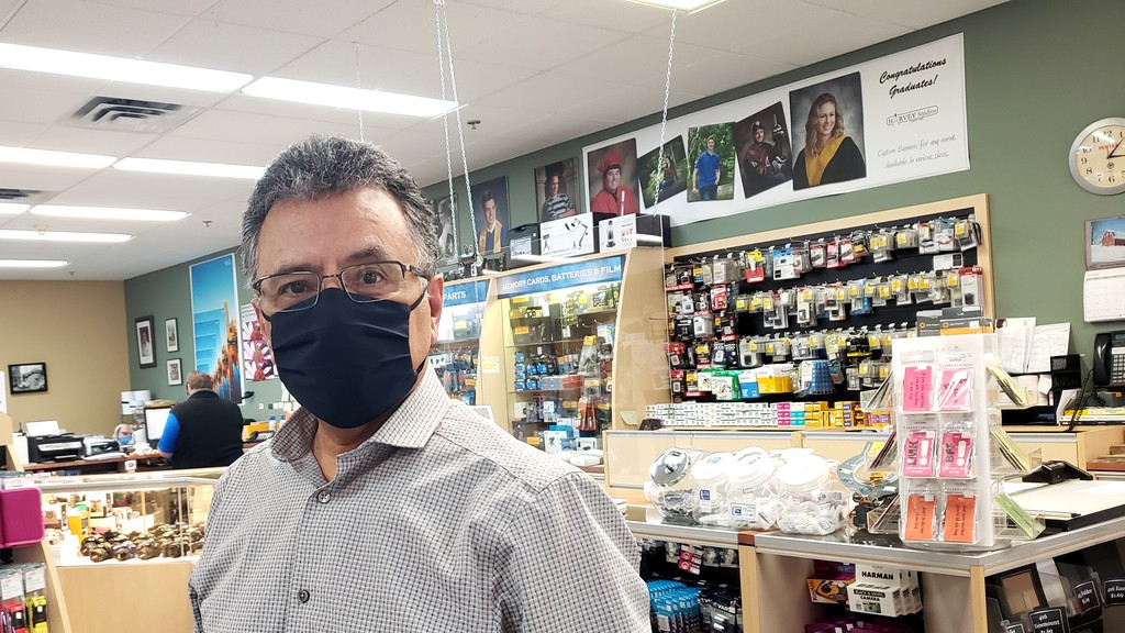 Mehrdad Bastan, owner of Harvey Studios in Fredericton, says the closure of photo centres at all Costcos next month could mean more business for his local photo printing lab.
