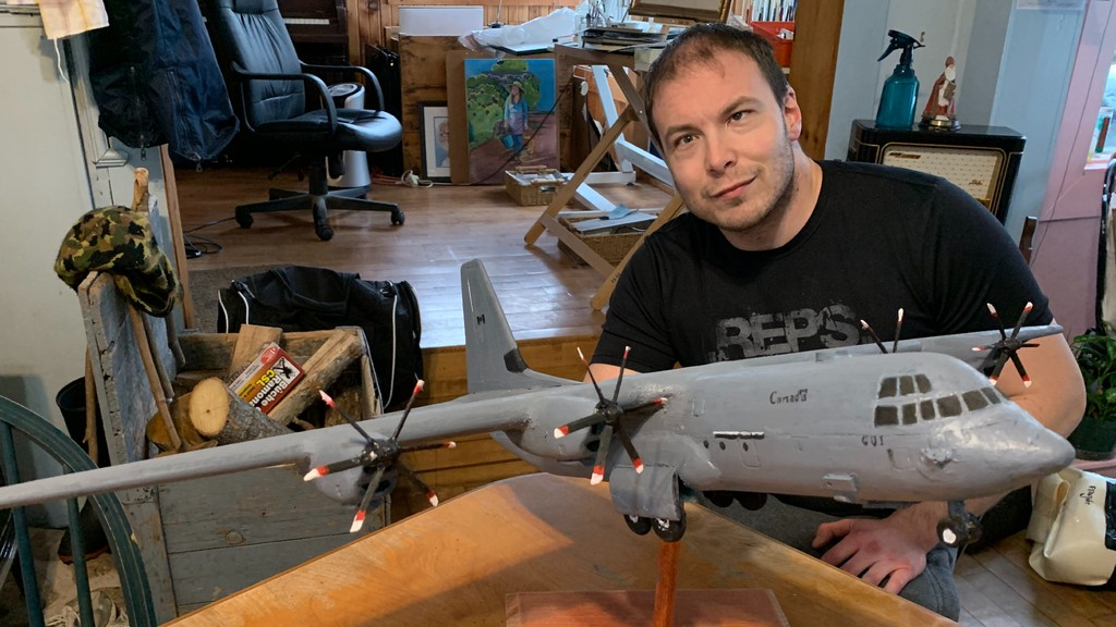 Military enthusiast Aaron Bouma with a model of a Lockheed Martin C-130J Super Hercules airplane he was commissioned to build. Bouma has been named vice chair of the Canadian Academy of Health Sciences Oversight Panel.