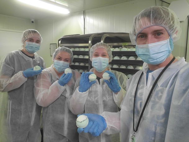 Stewart Farms team members Jess Leclair, Ashley Ross, Ashley Hamilton and Josh Lindsey show off the cannabis bath bombs being produced in St. Stephen.