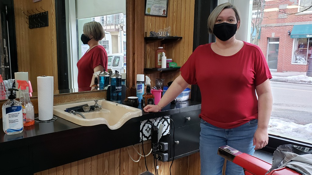 Shelly Woodcock, owner of Hashey's Barber Shop in downtown Fredericton, says it's unfair a business such as hers will be forced to close if the region goes to the red alert level during the pandemic.