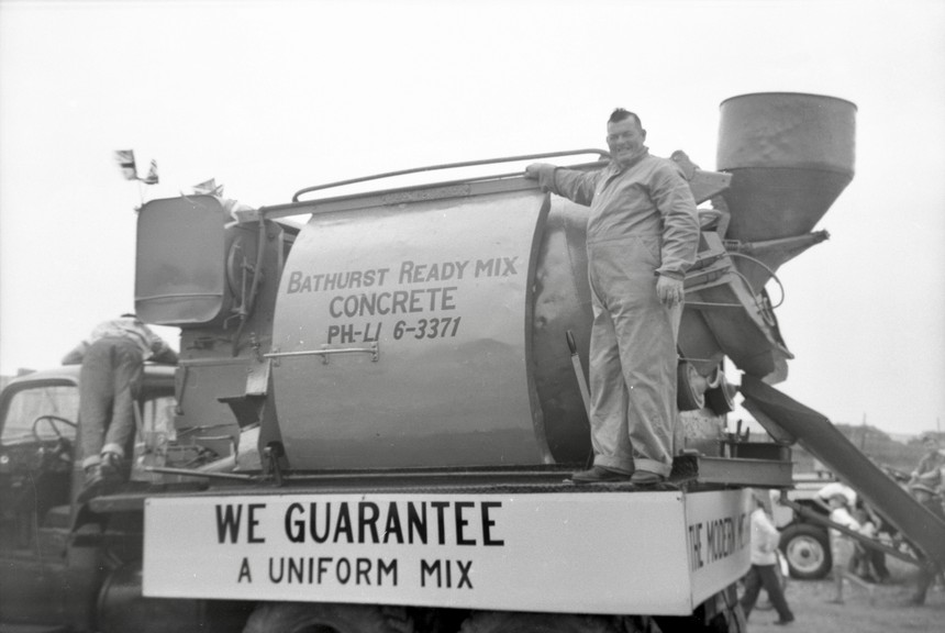 Pictured in an Angus Branch negative of a Bathurst Ready Mix parade float is Henry Ellis from Salmon Beach. The image is from the Bathurst Heritage Museum, and is estimated to be from the late 1950s or early 1960s. The business was owned by Kent's.