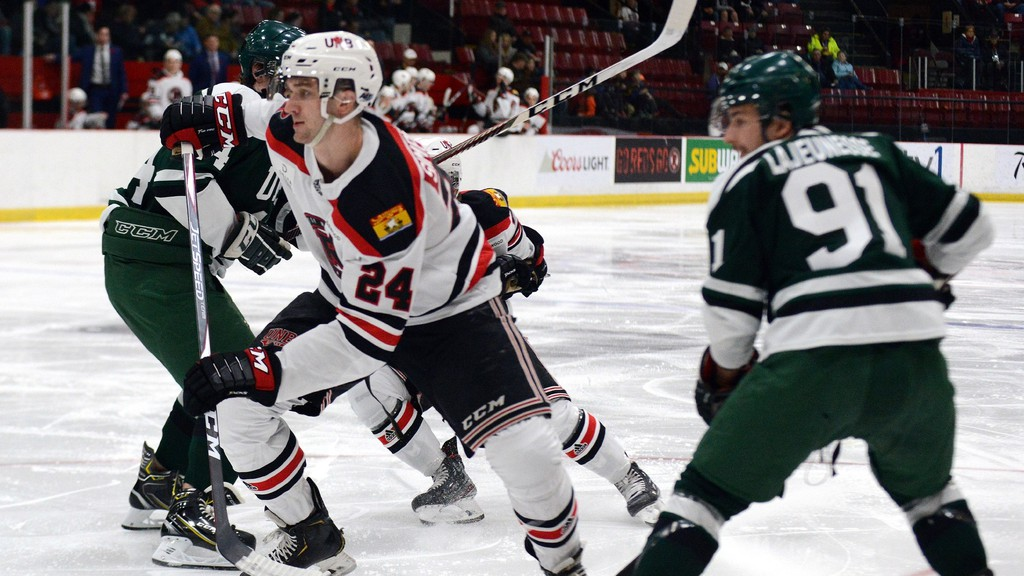 Former UNB Reds centre Mark Simpson is awaiting word on the Stockton Heat's training camp for the upcoming American Hockey League season.