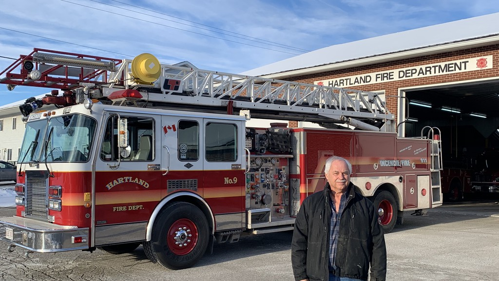 Hartland Fire Chief Mike Walton stands by the 1988 ladder truck his department is selling to the Liverpool Fire Department for $40,000. Walton has arranged for the truck to be shipped to its new owners on the Fundy Rose, the Saint John to Digby ferry.