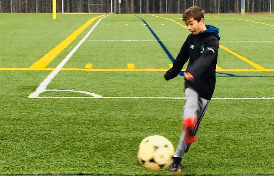 Henri Doucet, 13, has been an avid soccer player since he was four. He's hoping the Fredericton region will soon return to the orange phase of the province's COVID-19 recovery plan so he can enjoy winter indoor soccer at the UNB Dome.