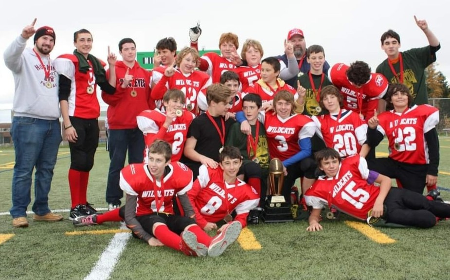 Andrew Allaby has always loved football. He's in the back row, in the beard, for a proud coaching moment: the first city football championship for the Devon Wildcats in minor football. The team went on to win the provincial chapmpionship in 2012.
