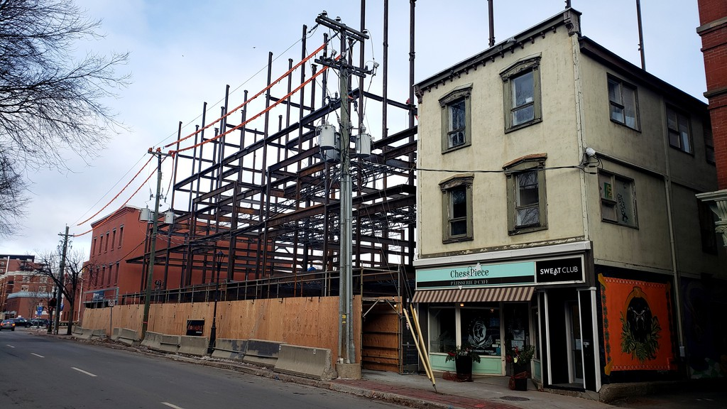 This file photo shows a new apartment building under construction on Queen Street in December. Fredericton's building permit numbers for 2020 show an overall drop in value, but a big jump in residential construction.