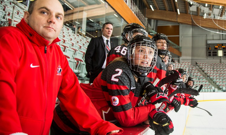 Equipment manager Serge LeBlanc, left, a Sainte-Marie-de-Kent native who resides in Grande-Digue, won gold with Team Canada at the IIHF world women's hockey championship on Tuesday in Calgary.