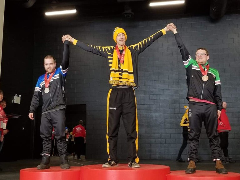 Alex Condly-Powell, right, on the podium after winning a bronze in snowshoeing at the 2020 Canadian Special Olympics Winter Games in Thunder Bay, Ont., last February.