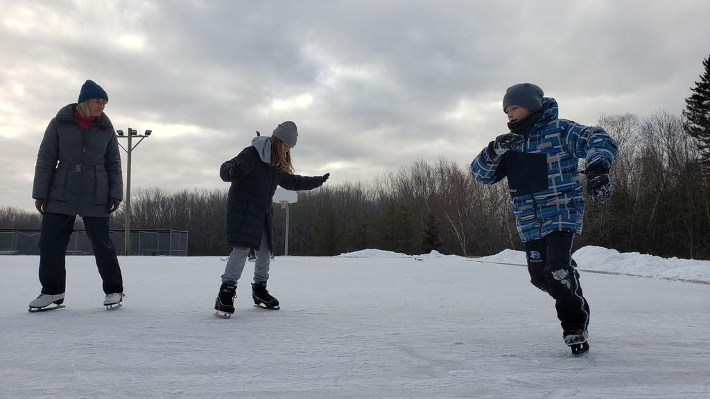 Natasha Tessmann, her daughter Anya and son Eric enjoy Mitch Clarke outdoor rink last Christmas Eve.