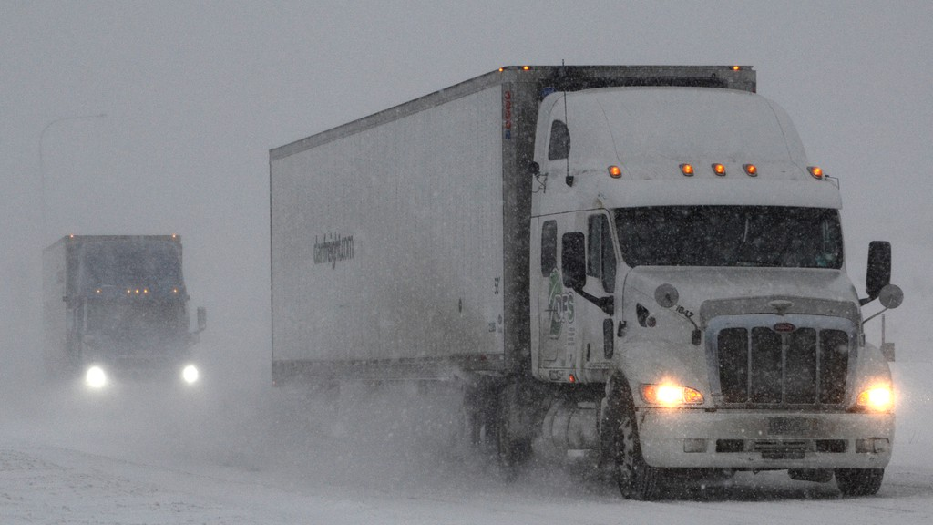Tractor-trailers slog through packed snow on the Trans-Canada Highway in this file photo. SNC Lavelin highway operations reports there have been three collisions between snowplows and other vehicles on the Trans-Canada Highway between the Quebec border and Long's Creek this winter.