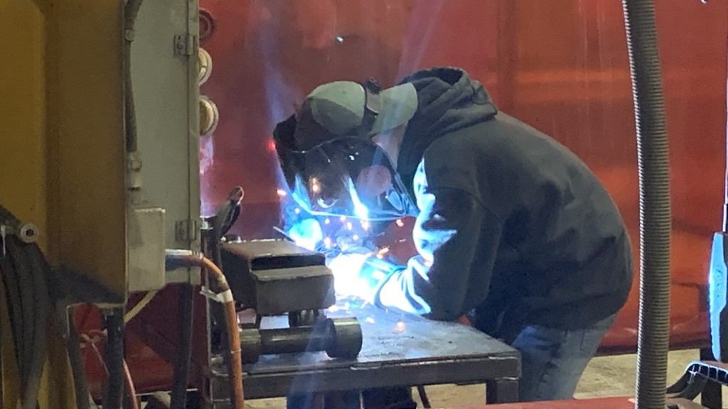 Ethan Curtis welds in one of the workshops set up at BWS Manufacturing for the new NBCC MIG welding program.
