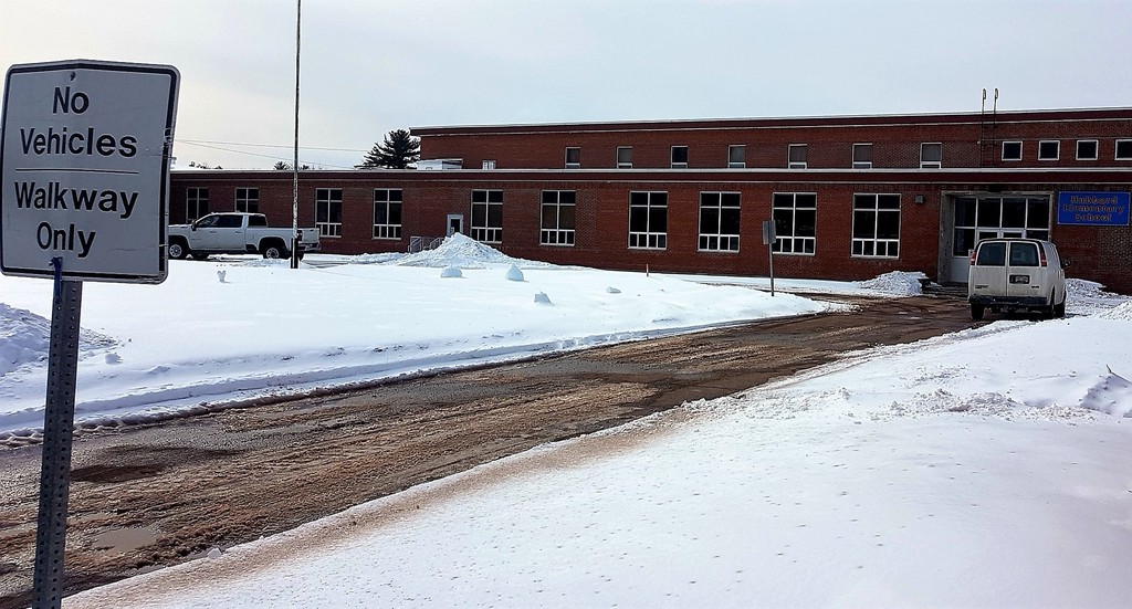 Hubbard Elementary School, closed since last week to students due to heating problems, looked deserted Thursday with the exception of two white truck