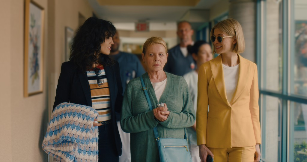 Eiza Gonzalez, Dianne Wiest, and Rosamund Pike, from left, in a scene from I Care a Lot.