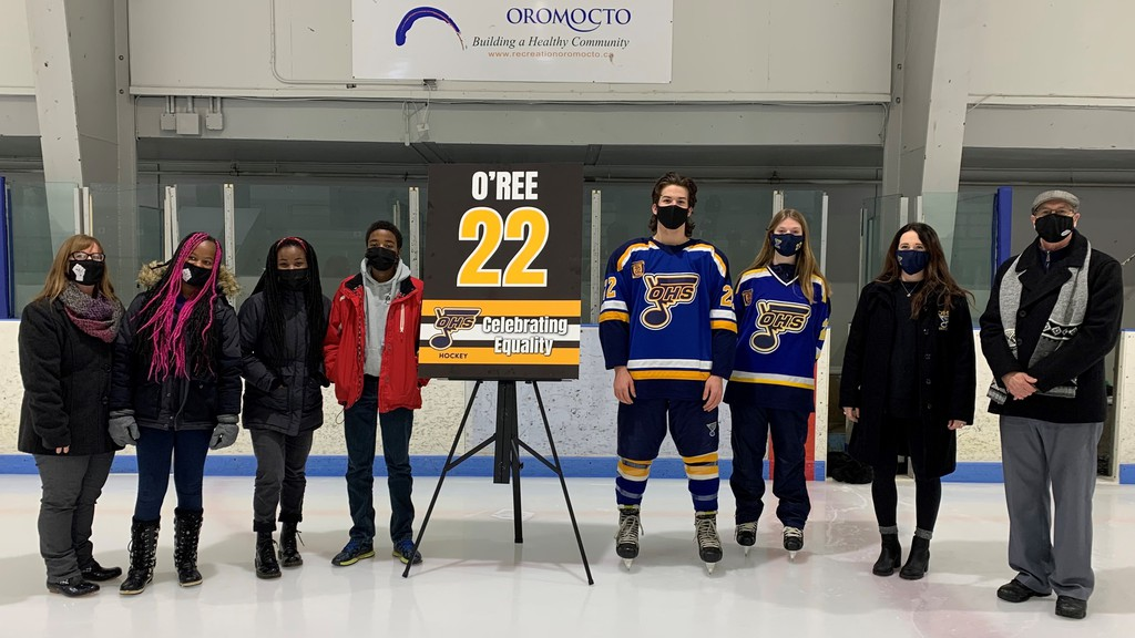 Oromocto High School held a ceremony at Kings Arrow Arena on Thursday night to celebrate Black History Month and Fredericton's Willie O'Ree, who became the first Black man to play in the National Hockey League when he suited up for the Boston Bruins on Jan. 18, 1958. On hand for the unveiling of an O'Ree 'Celebrating Equality' banner were, from left, OHS teacher and Black History Committee supervisor Krista Kirkbride, Harold Peterson Middle School student Kennah Kirkbride, OHS Black History Committee members Kalkidan Burke and Kaleb Burke, OHS Blues No. 22 hockey player Cameron Dickey, OHS Lady Blues No. 22 hockey player Kaylee Myra, OHS Lady Blues head coach Taylor Maschmeyer and Oromocto Mayor Bob Powell.