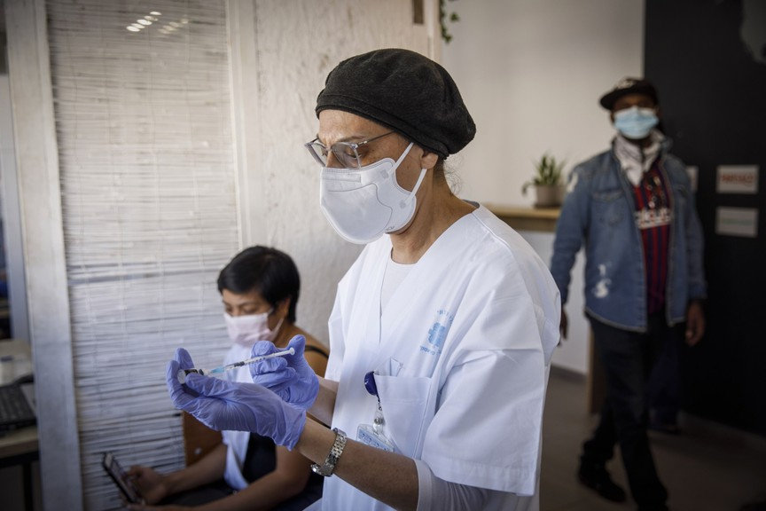 A nurse prepares a dose of the Pfizer-BioNTech COVID-19 vaccine for a patient at a vaccination centre in Tel Aviv, Israel.