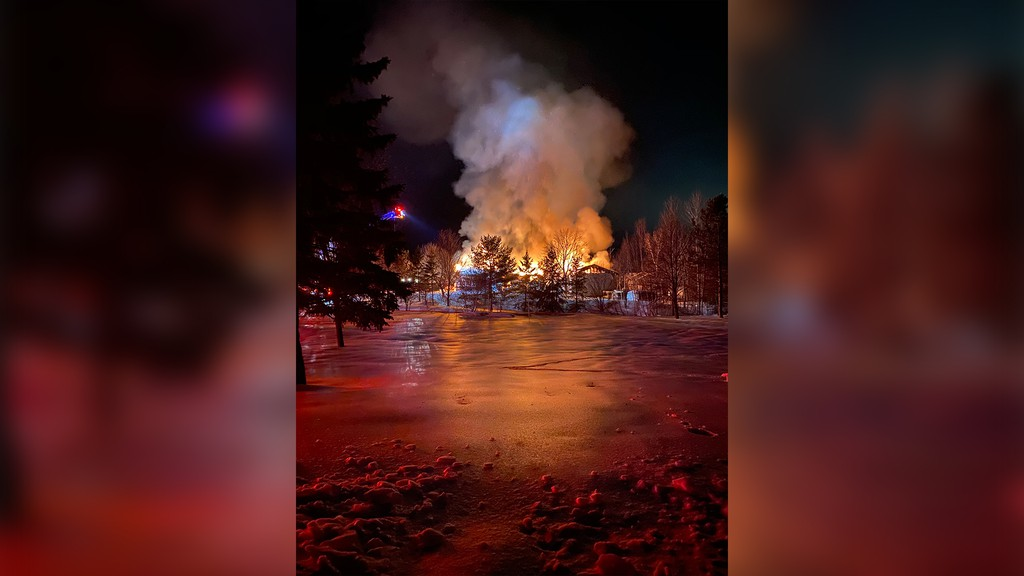Neighbour Ben Carr captured this photo as Sally Salgado's home burned to the ground Thursday night. Salgado escaped the fire, crawling through the smoke, her son Jeremy told the Kings County Record Friday morning.