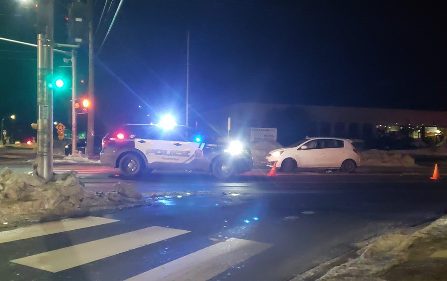 Fredericton police block off Prospect and Smythe streets Friday night following a series of incidents that saw multiple motor vehicle collisions occur, including one involving a police car. Police say one man is in custody in connection with the incident and another is being sought.