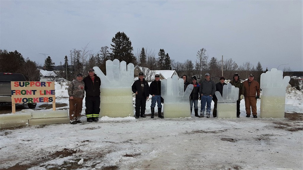 World Pond Hockey Championship volunteers in Plaster Rock got together to build a 'helping hands' ice sculpture as a tribute to frontline workers. The tournament had to be cancelled this year due to the pandemic but volunteers still wanted to share a positive message. From left are Todd Gamblin, Clem Robertson, Ron Larlee, Ricky Reed, Terry Gamblin, Allan Jenkins, Luke Cooper, John Bucci, Paul McAskill and Harley Elliott.
