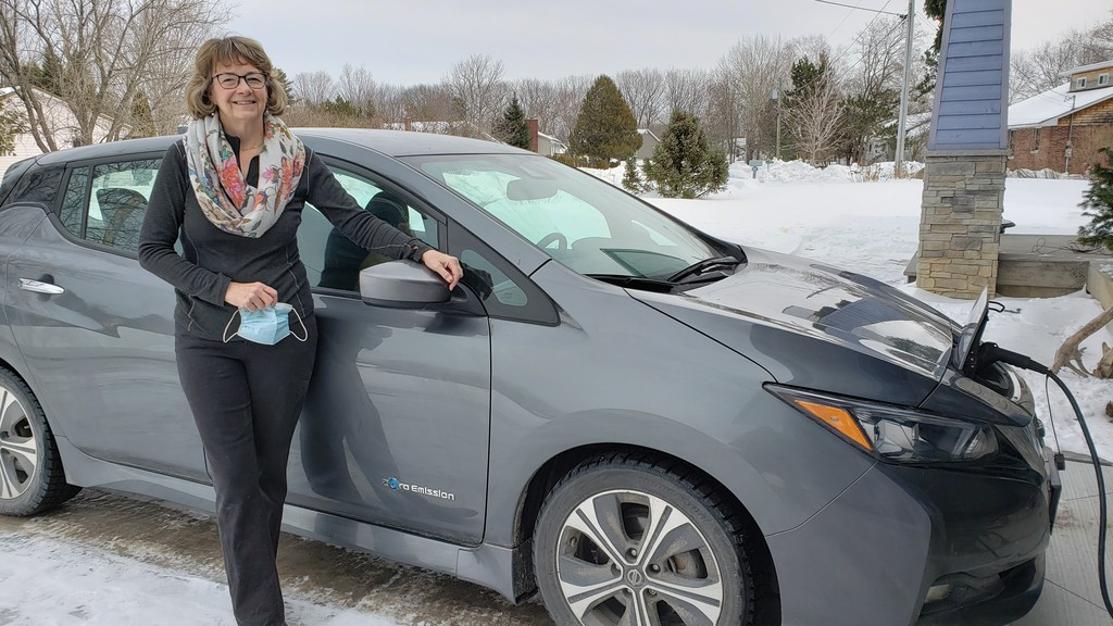 Margo Sheppard, of Fredericton, demonstrates how easy it is to charge her 2018 Nissan Leaf electric vehicle. The province was unable to meet its target of having 2,500 electric vehicles on the road by the end of 2020.