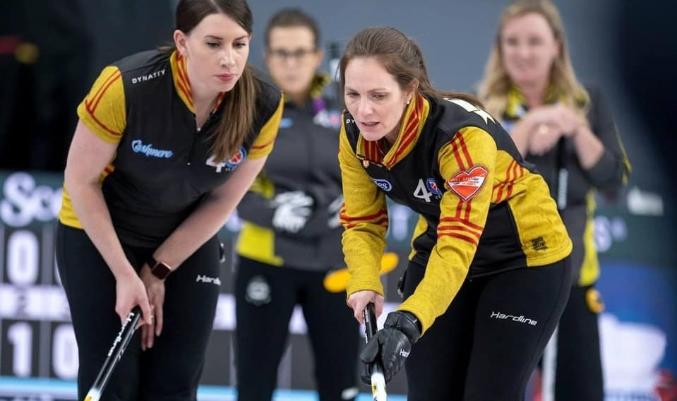 New Brunswick third Jaclyn Tingley, left, and skip Melissa Adams discuss strategy during the Scotties Tournament of Hearts women's curling championship ongoing in a bubble in Calgary.