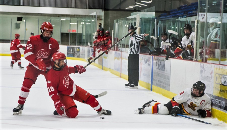 Andrew Gweon (16) of the Fredericton Office Interiors Caps falls into teammate Matthew McHatten after colliding with Dick Maclaren of the Saint John Vito's in N.B./P.E.I. Major U18 Hockey League action Jan. 3 at Willie O'Ree Place. The teams haven't played since, with New Brunswick still in the orange phase of the province's COVID-19 recovery plan.