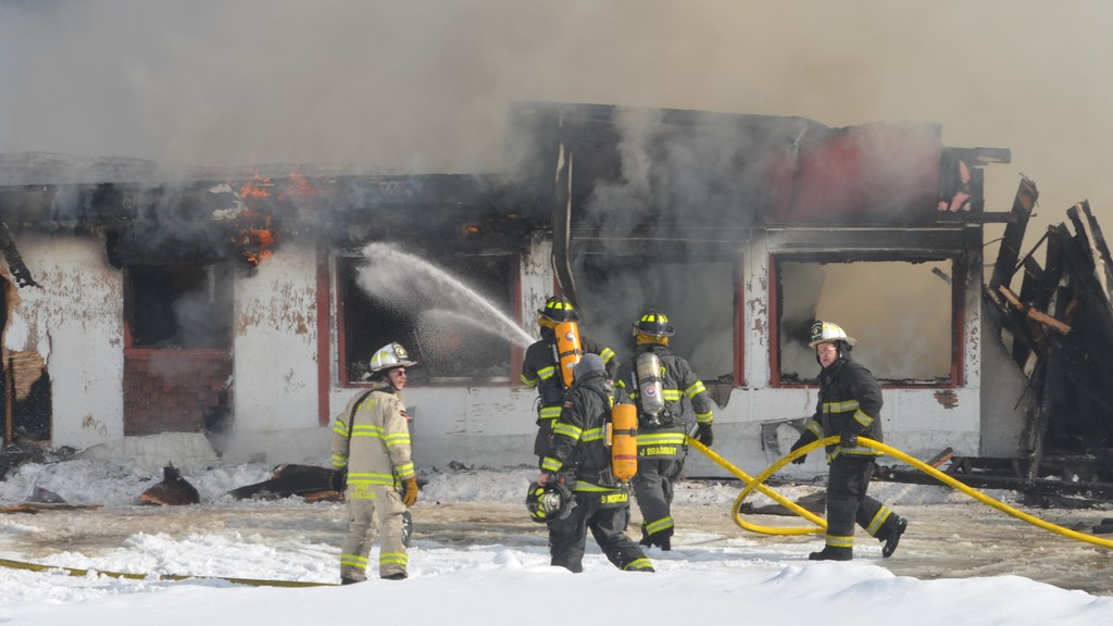 Woodstock firefighters battle a structure fire in Pembroke, a community north of Woodstock, on Tuesday afternoon.