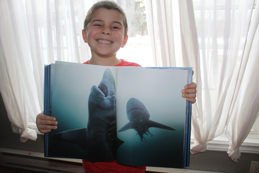 Bryannah James is a reporter at The Northern Light newspaper who writes about her children Colton and Jackson in her weekly Mom at Home column. Colton is pictured above holding his book SHARKS.