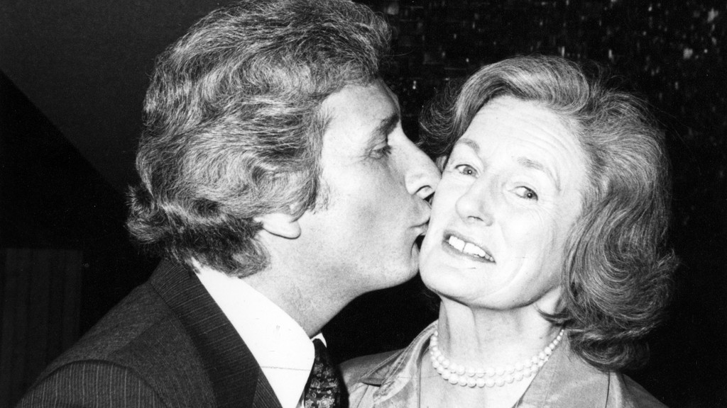 University of New Brunswick president James Downey kisses Lady Violet Aitken at the ceremony installing her as UNB chancellor in 1982.