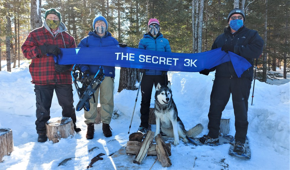 The Silverwood Bushwhackers, including, from left, race director Tom Healy, wife Ulrica Healy, Michele Coleman, husband Dan Coleman and their 14-year-old Husky, Ishka, will be doing a 3K snowshoe loop as part of The Secret 3K. The annual run/walk event to celebrate gender equality and safe and inclusive spaces will be held virtually due to COVID-19 on March 3 across Canada.