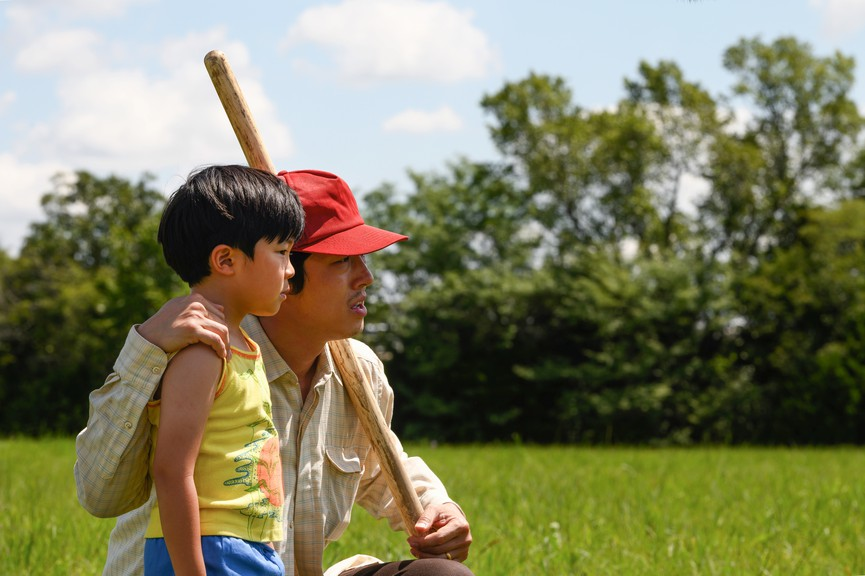 Alan S. Kim and Steven Yeun, from left, in a scene from Minari.