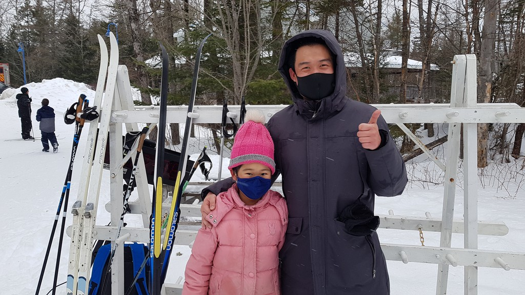 Adam Zhu and his eight-year-old daughter Sarah are among the newcomers to the area who are participating in a program to teach immigrants how to cross-country ski.